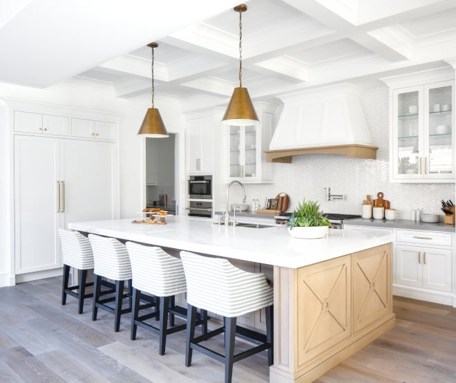 a white kitchen with a white oak wood kitchen island