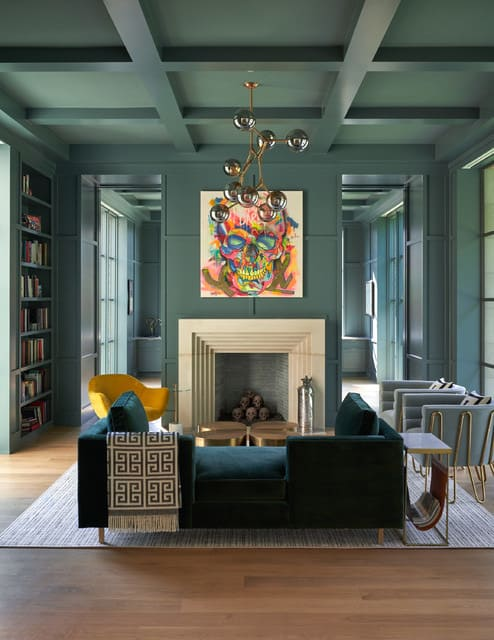 modern green den with green walls and green ceiling paint