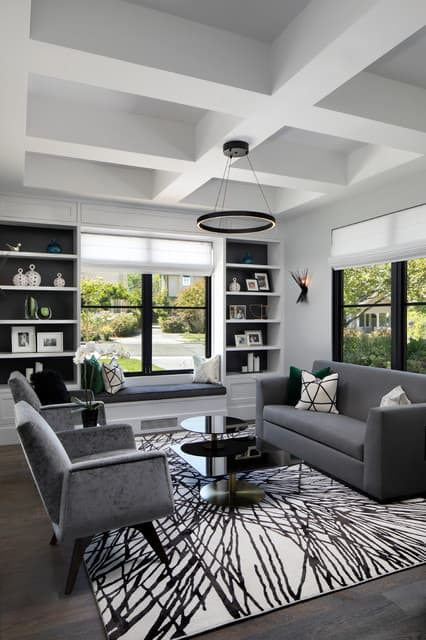 modern gray and white den with coffered ceiling