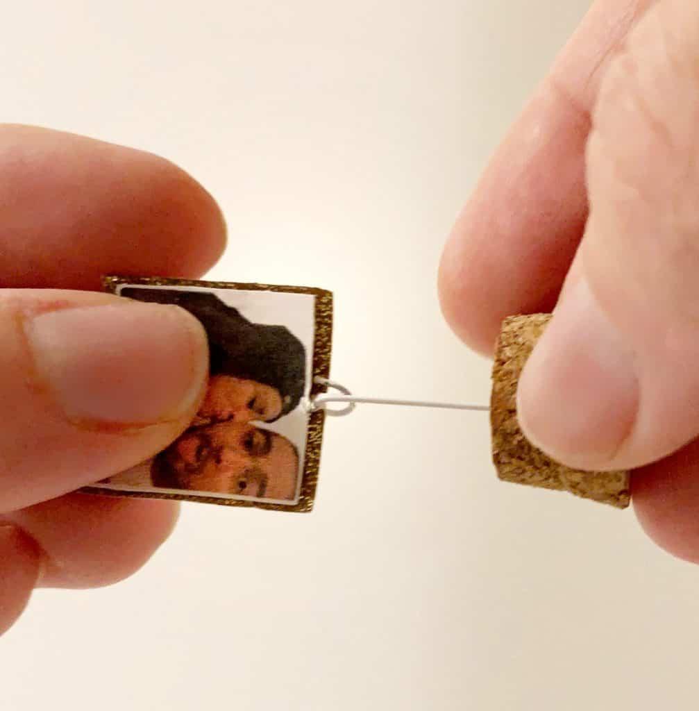 a pin through a photo