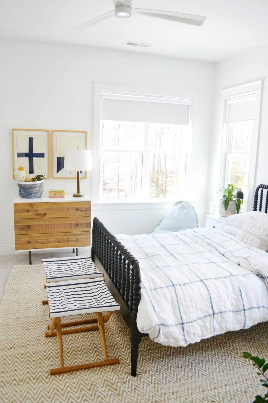 Jenny Lind bed with dresser and nautical framed art