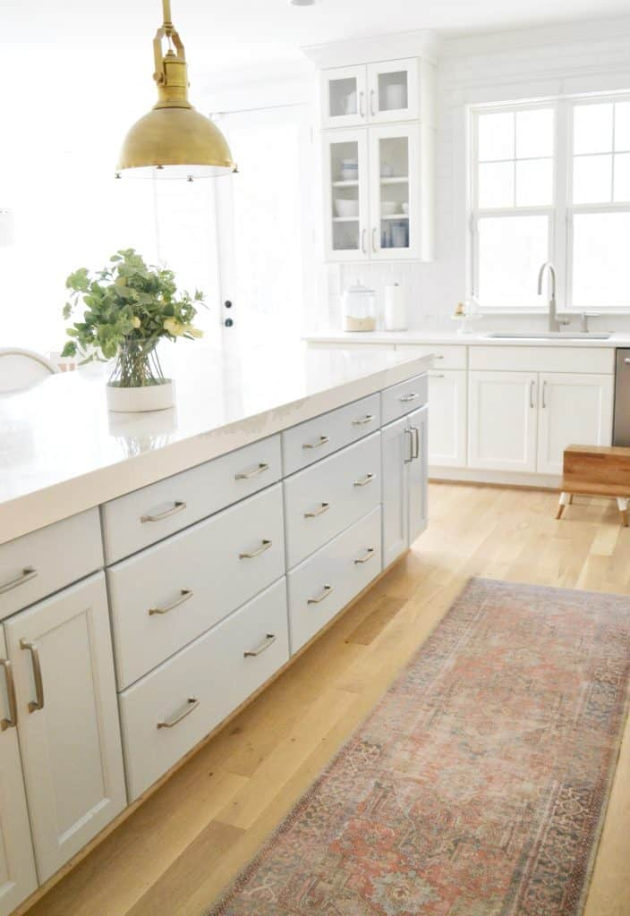 a vintage looking runner rug in a kitchen