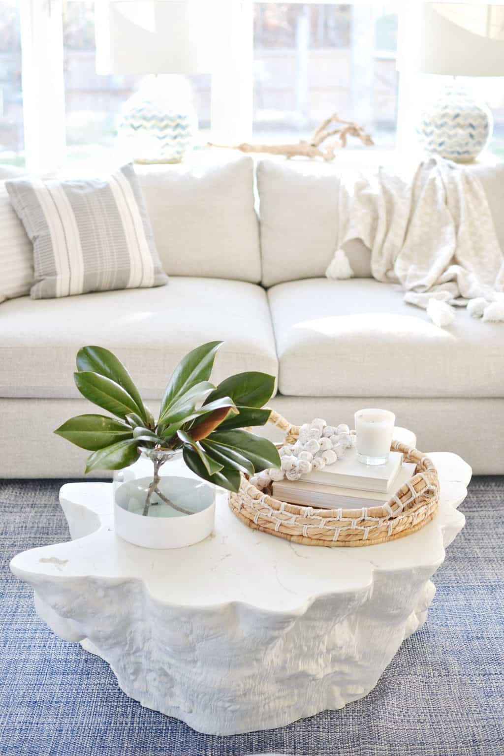 coffee table styling in a blue living room