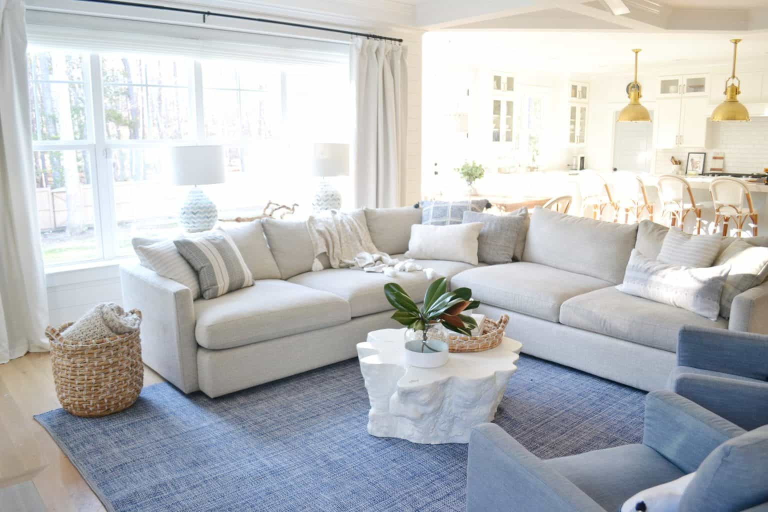 a blue living room with a white coffee table