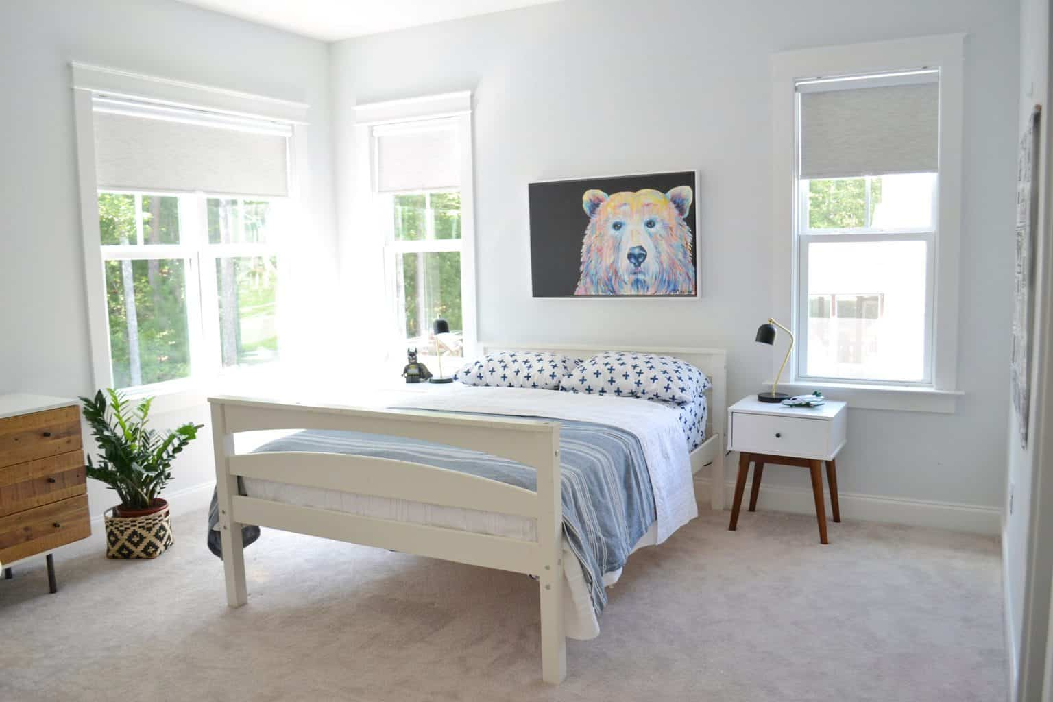 child's bedroom with a white bed in it