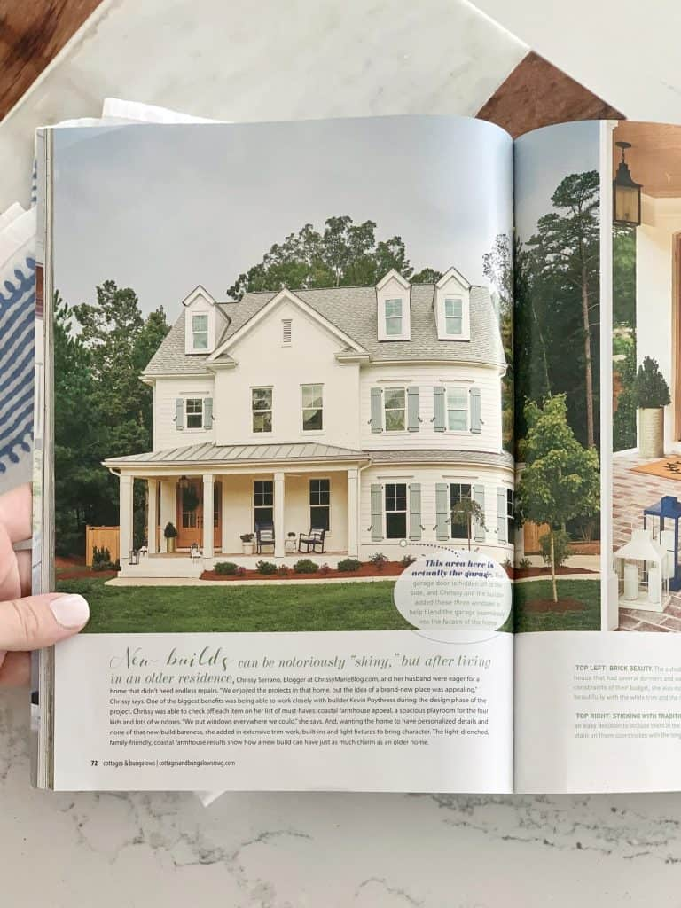 cottages and bungalows magazine open to a white farmhouse