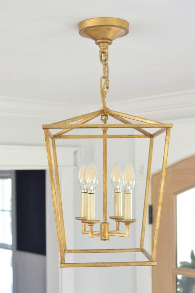 close up of visual comfort lantern in a foyer