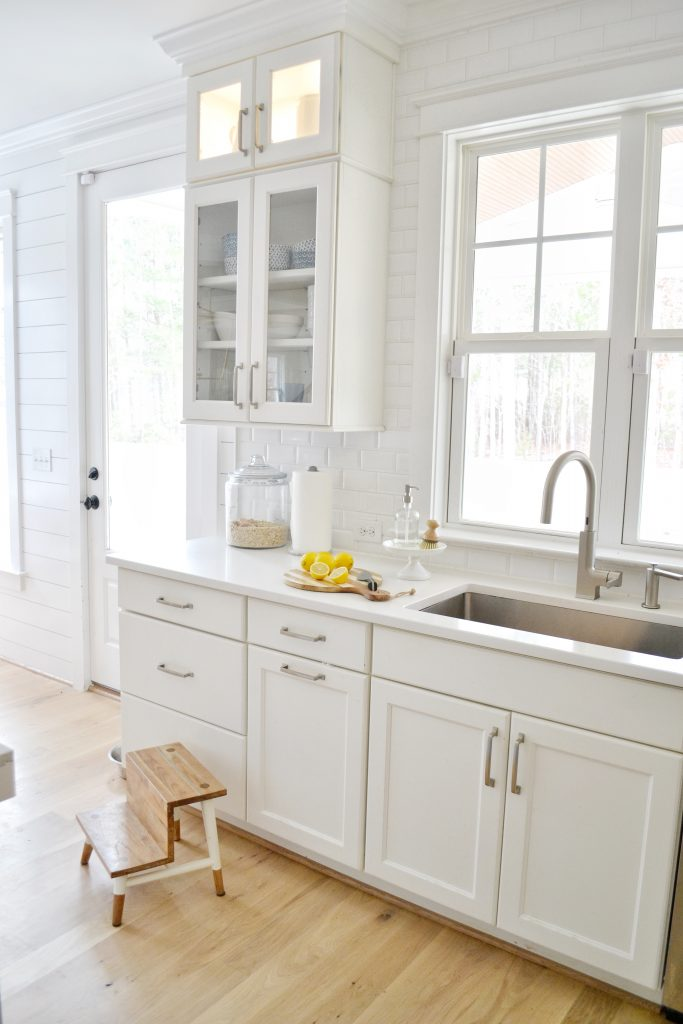 kids step stools in a white kitchen