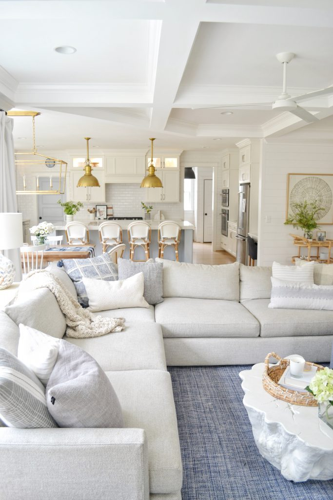 living room and kitchen with brass high end lighting