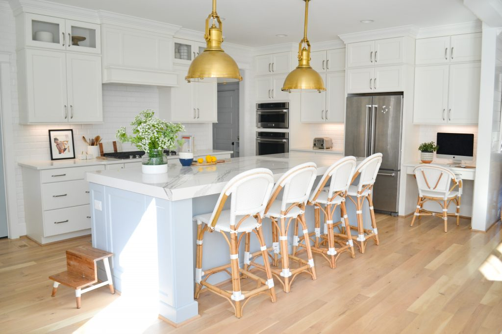 blue island with white cabinetry in a kitchen