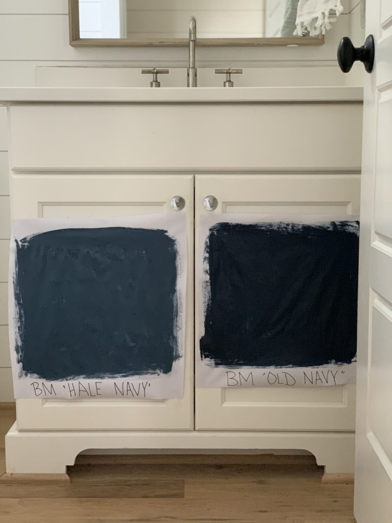 white bathroom cabinet with hale navy paint and old navy paint