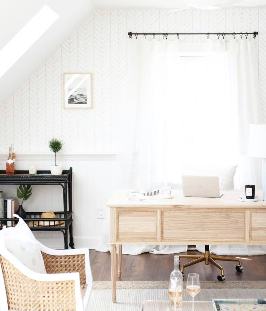 a white home office with a feminine wood desk