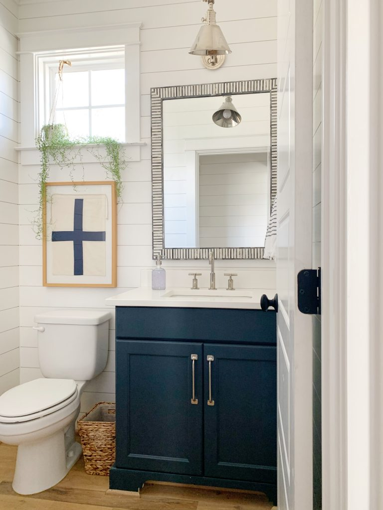 bathroom with hale navy painted vanity and bone inlay mirror