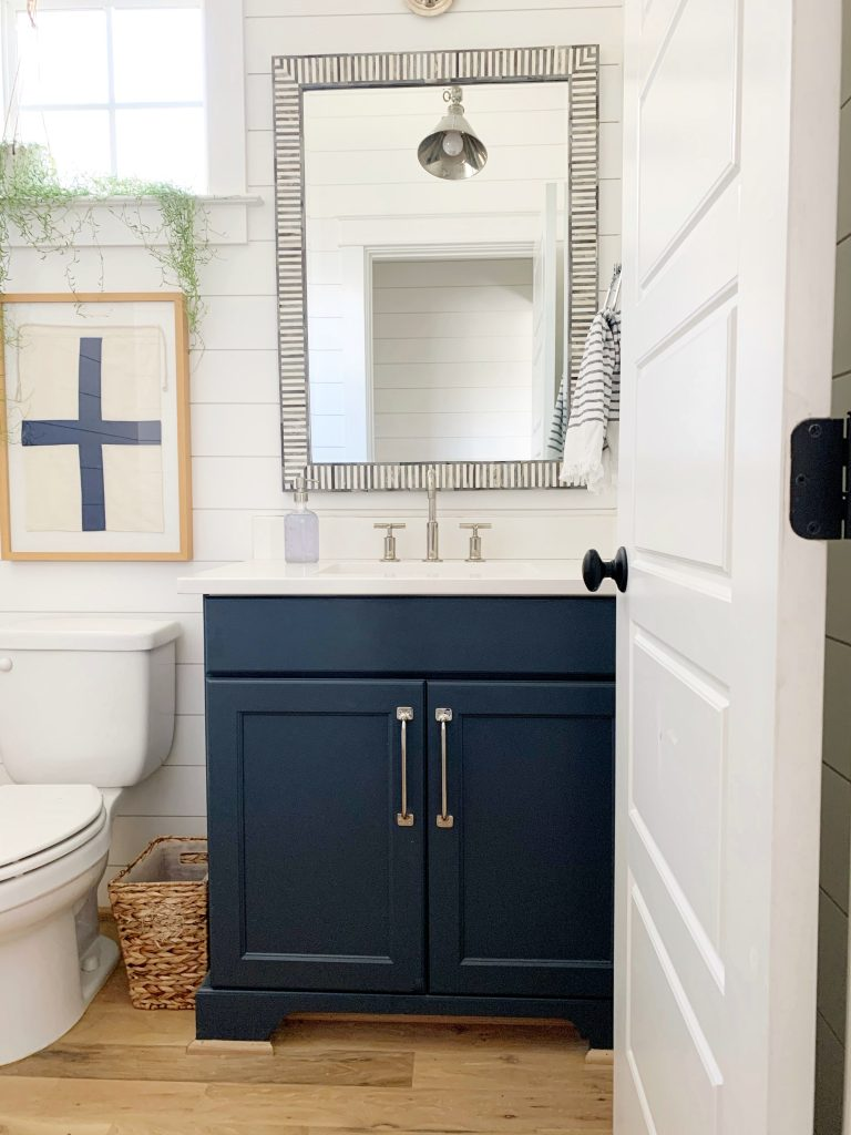 blue painted bathroom cabinets in a bathroom with shiplap