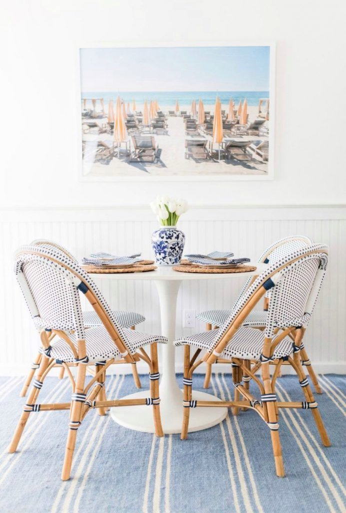 bistro chairs around a white dinning table