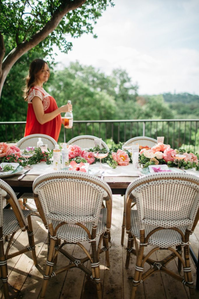 outdoor bistro chairs on a deck with flowers