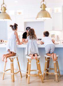 3 kids on backless riviera stools