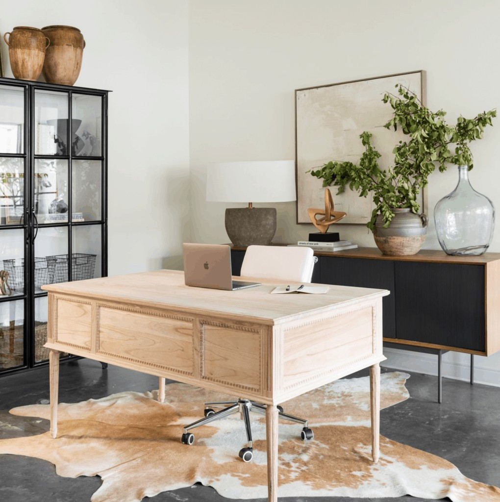 an industrial office with a beautiful feminine desk