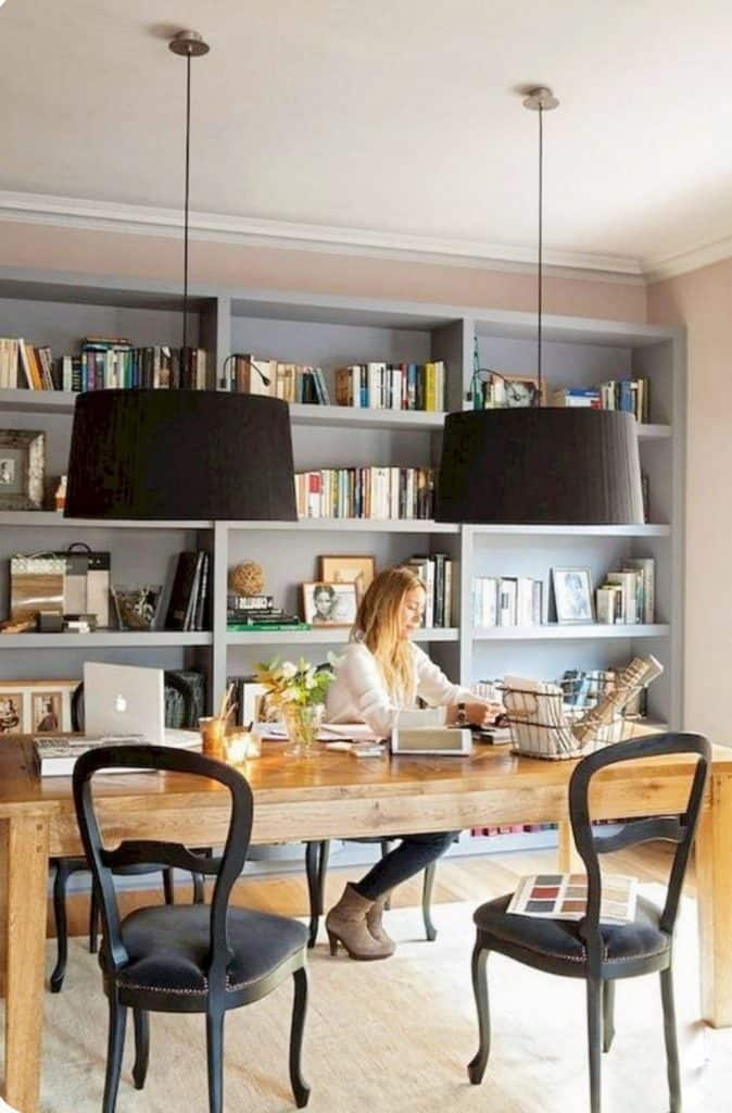 feminine table with two pendant lights over it