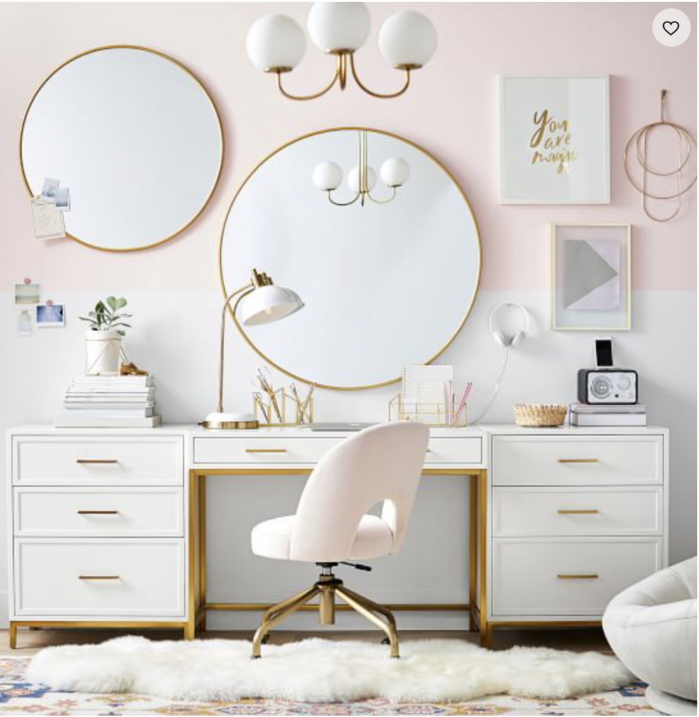 white and brass feminine desks with mirrors above it