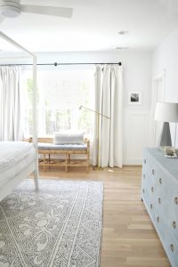 white drapes in an all white bedroom