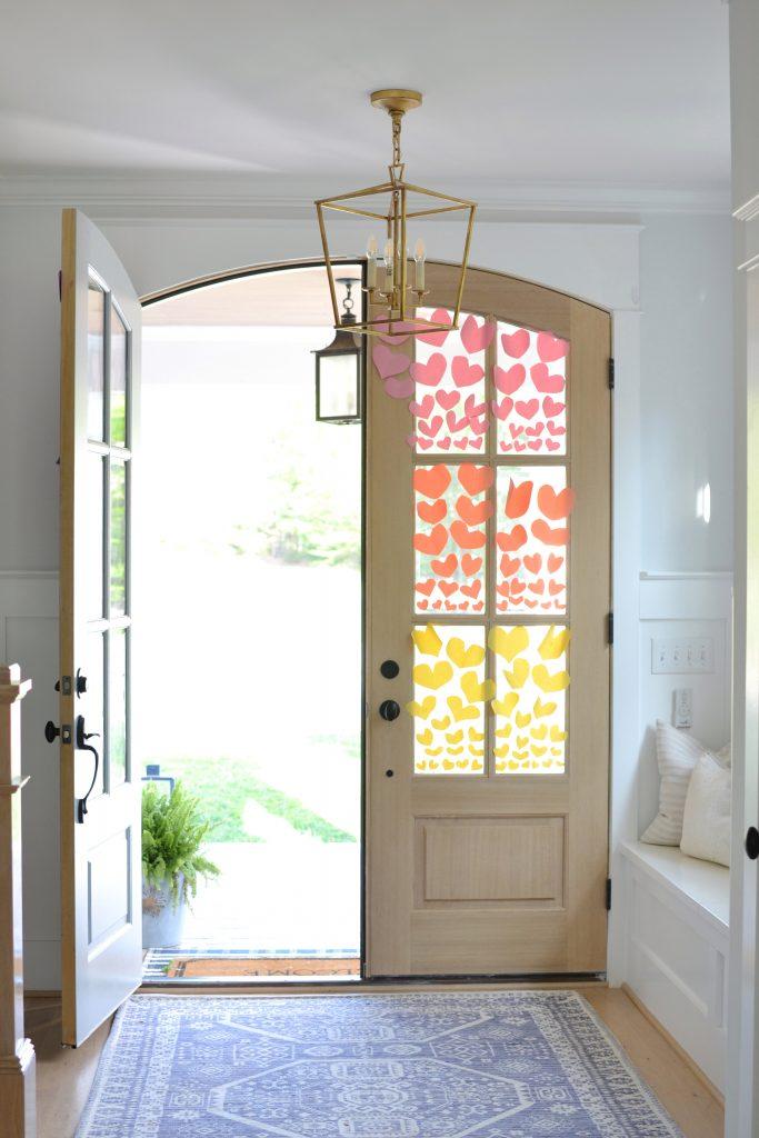 entry with double doors and 1 door open
