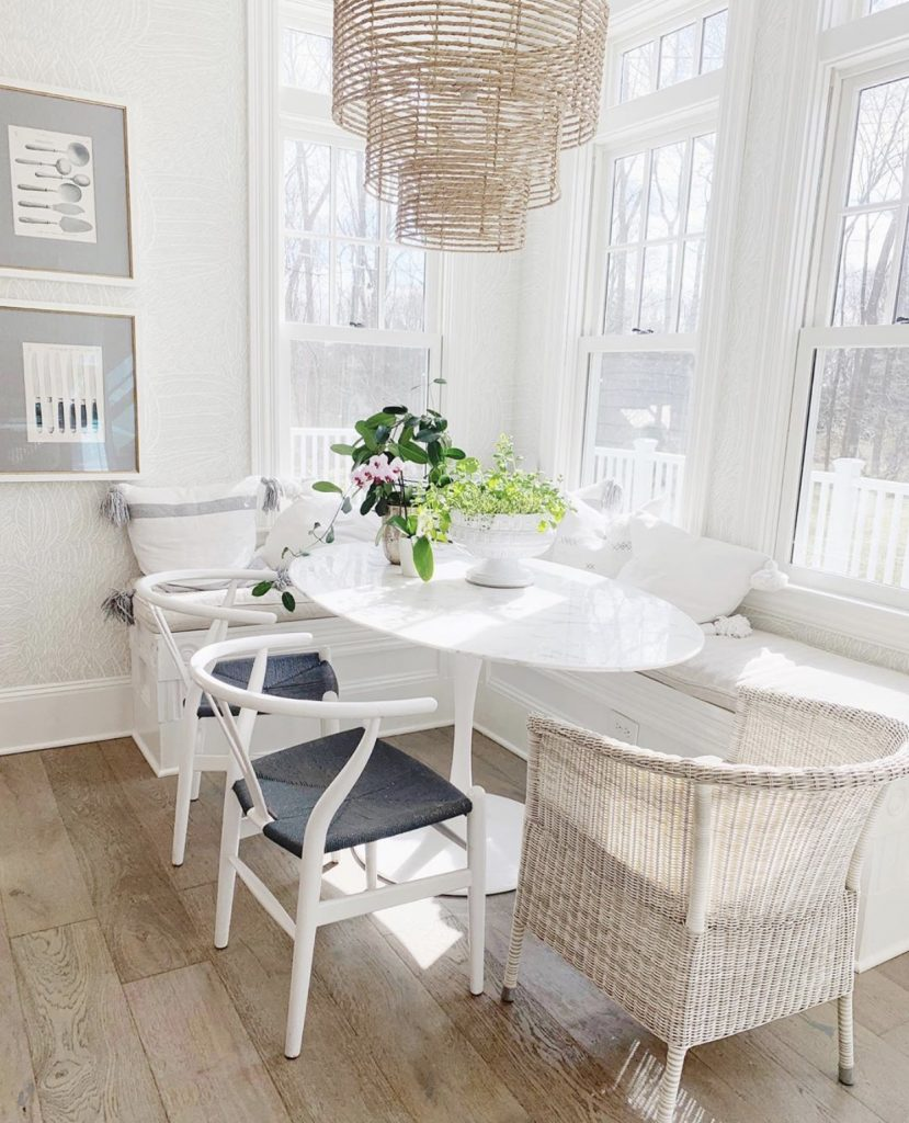 white kitchen table in a nook