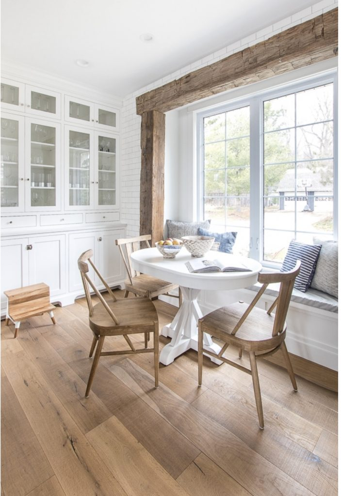 round white dining table at a bench in kitchen