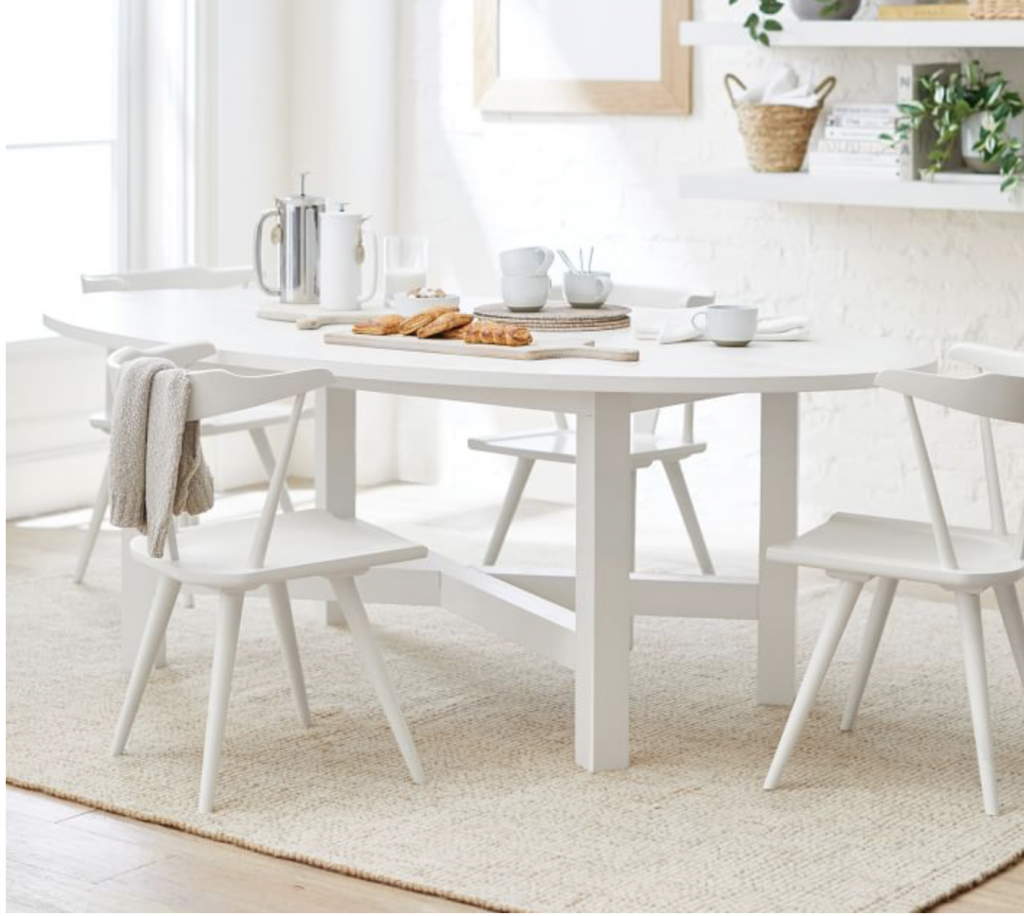white oval table for a beach house