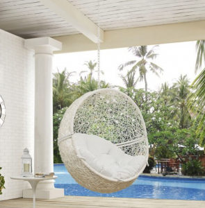 white outdoor hanging chair by a pool