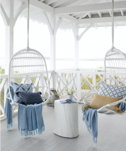 2 white hanging chairs