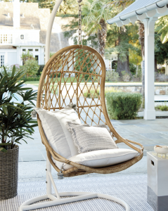 outdoor hanging chair on a stand in a backyard