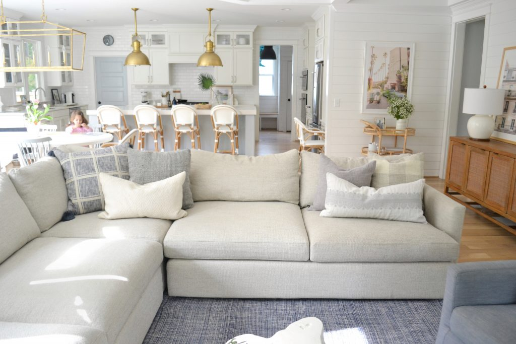 throw pillows on a grey sectional couch