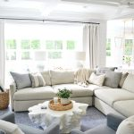 sectional with throw pillows on it