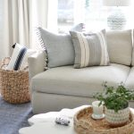 throw pillows on a grey couch in a living room