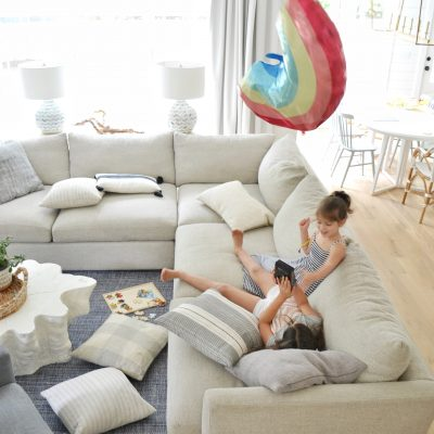 kids on a couch playing in a living room