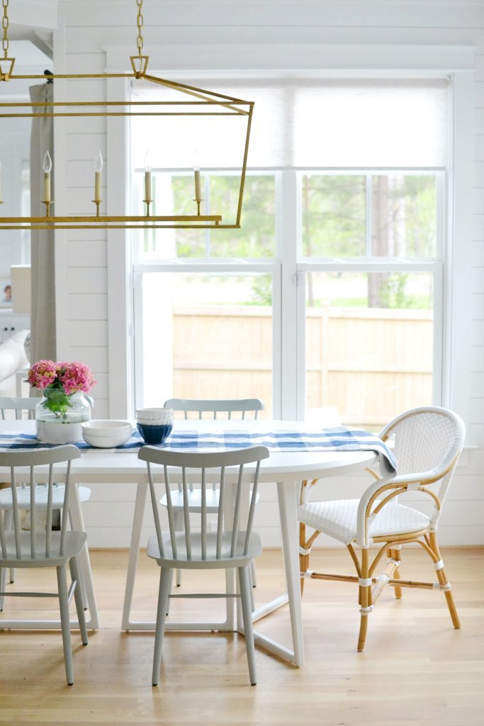 kitchen table nook in a blue and white kitchen