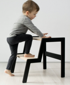 kids step stools that are black with a child climbing up