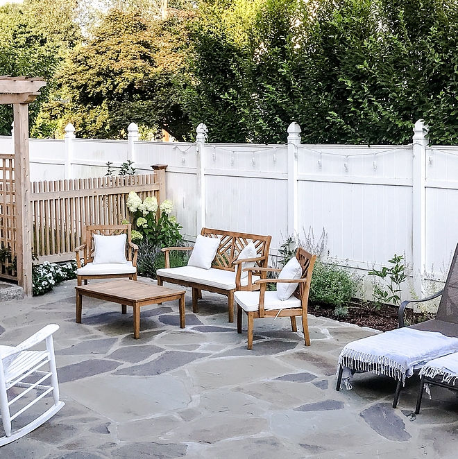 irregular bluestone in a backyard with a white fence