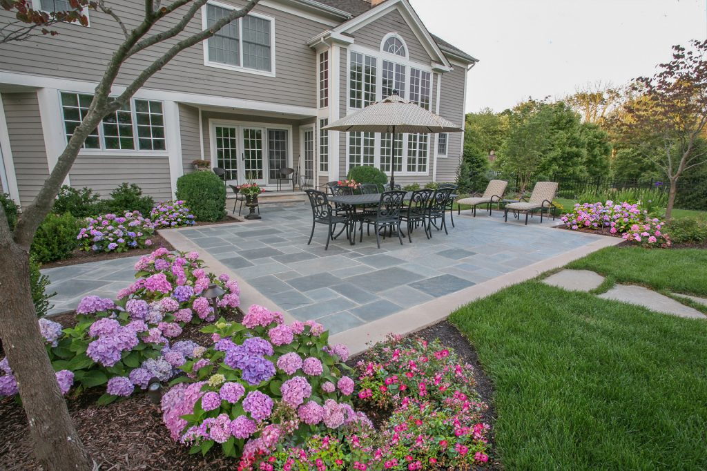 backyard with beautiful flowers and patio