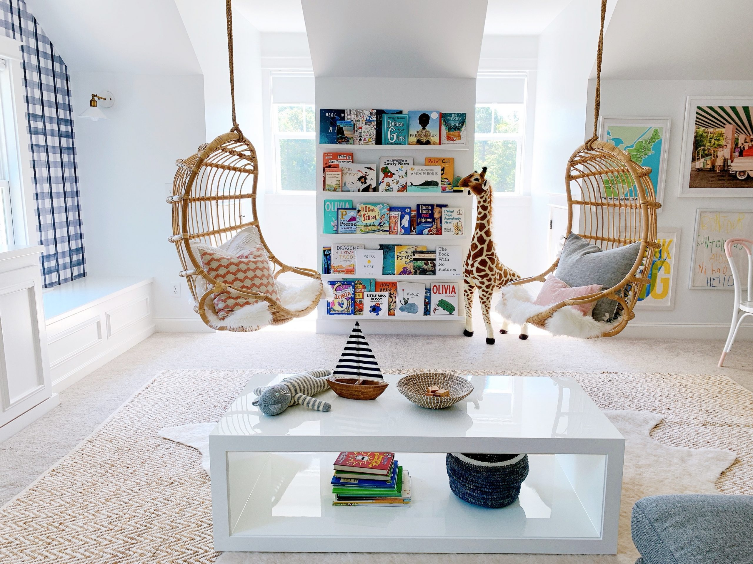 hanging rattan chairs with atelier coffee table in a playroom