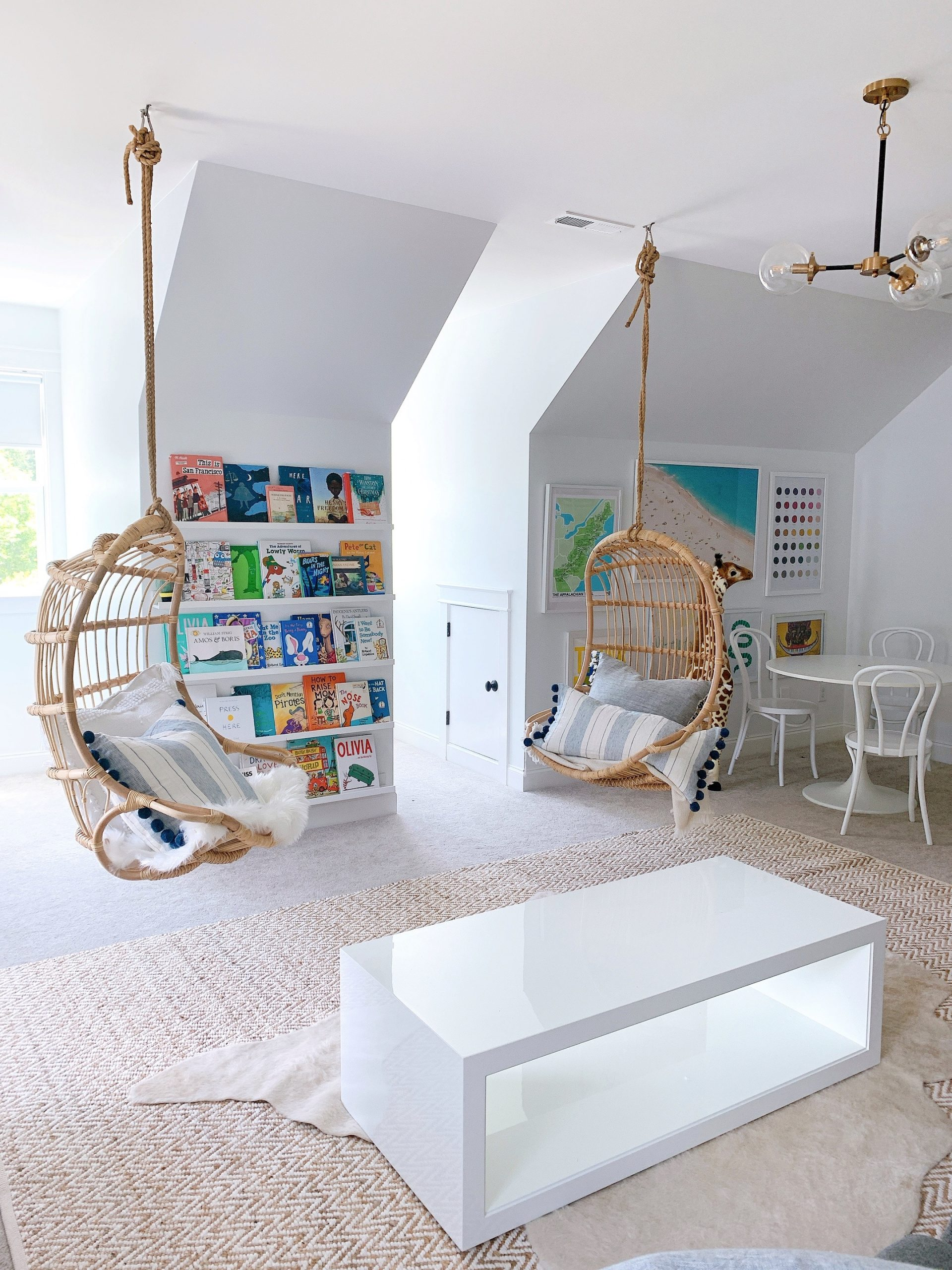 a playroom with colorful books on the walll