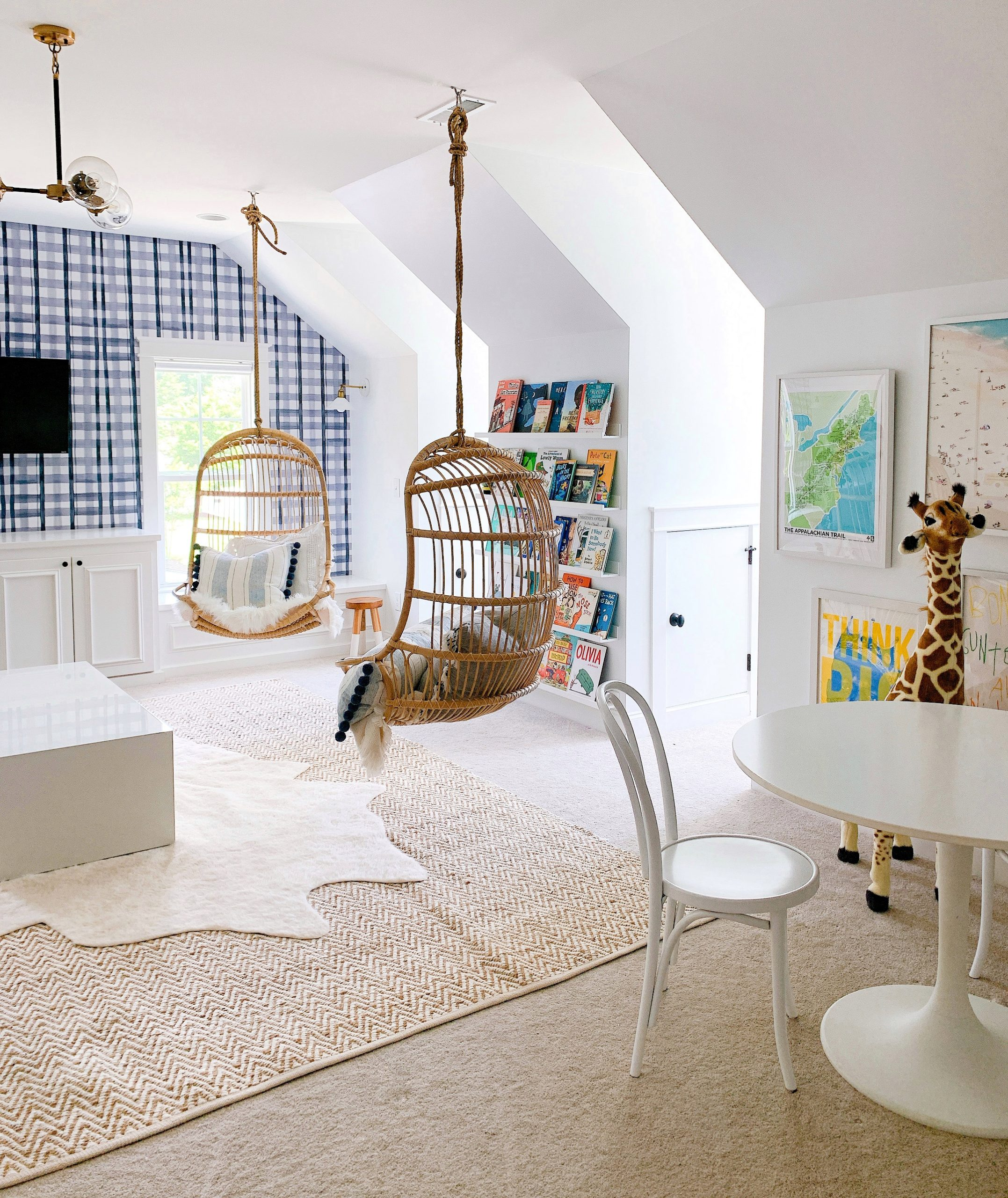 two hanging rattan chairs in a playroom