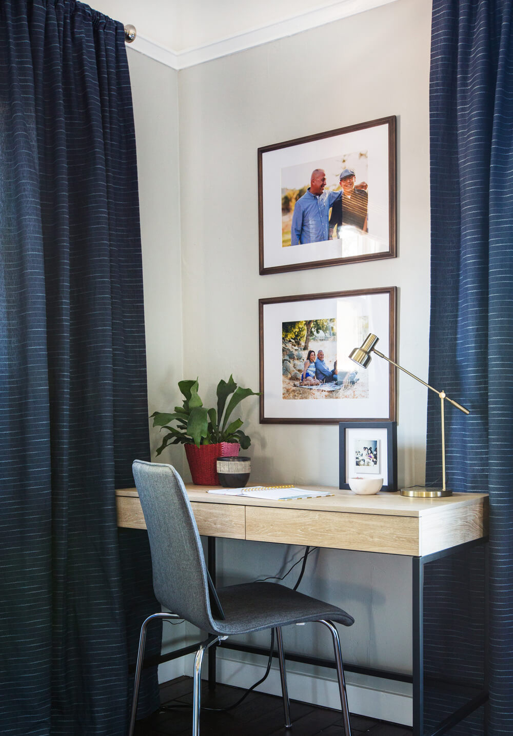 a home office desk with a cute chair and a plant