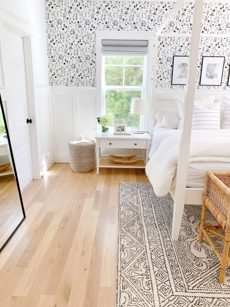 a black and white bedroom with black and white wallpaper