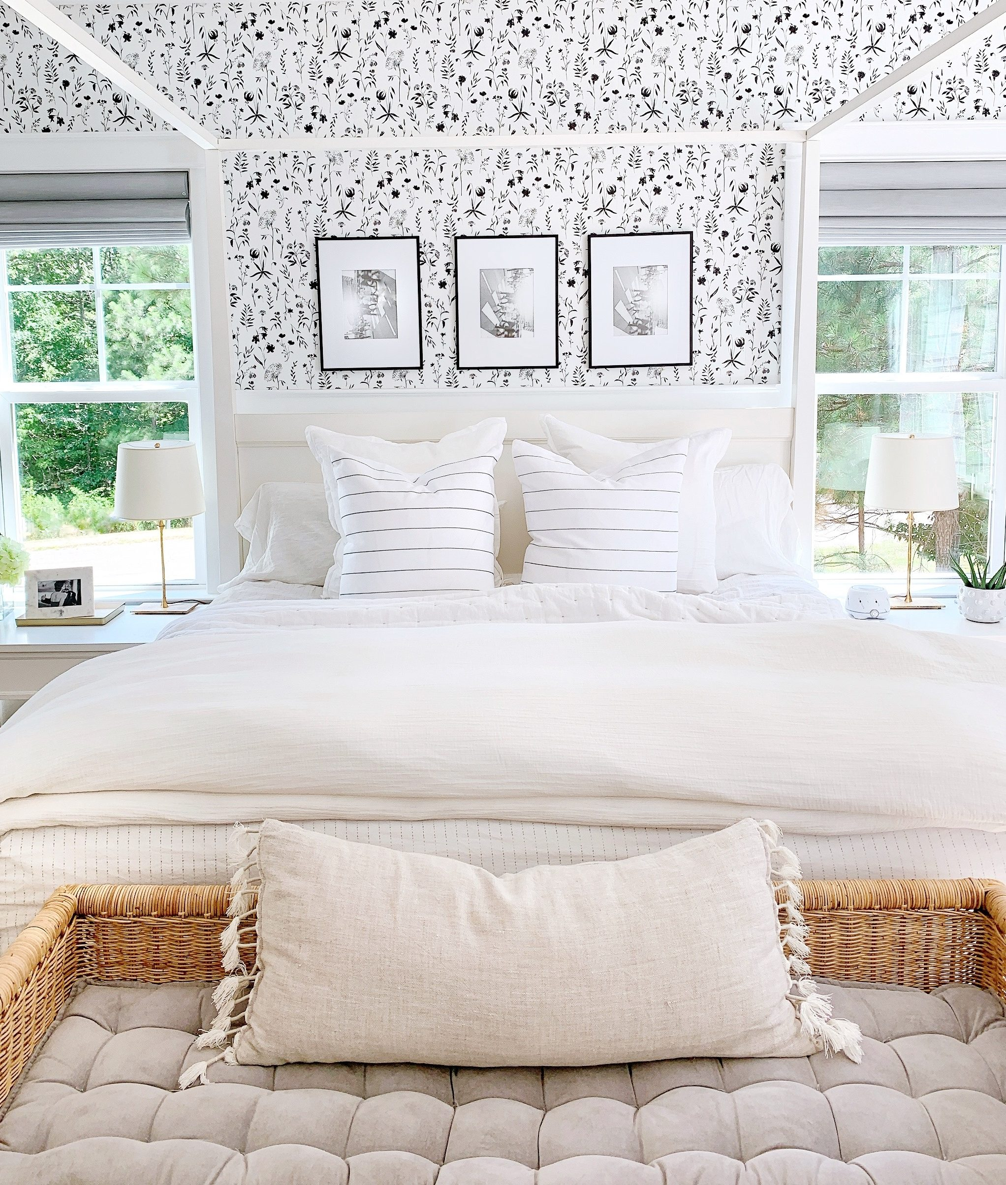 black and white floral wallpaper on a bedroom wall