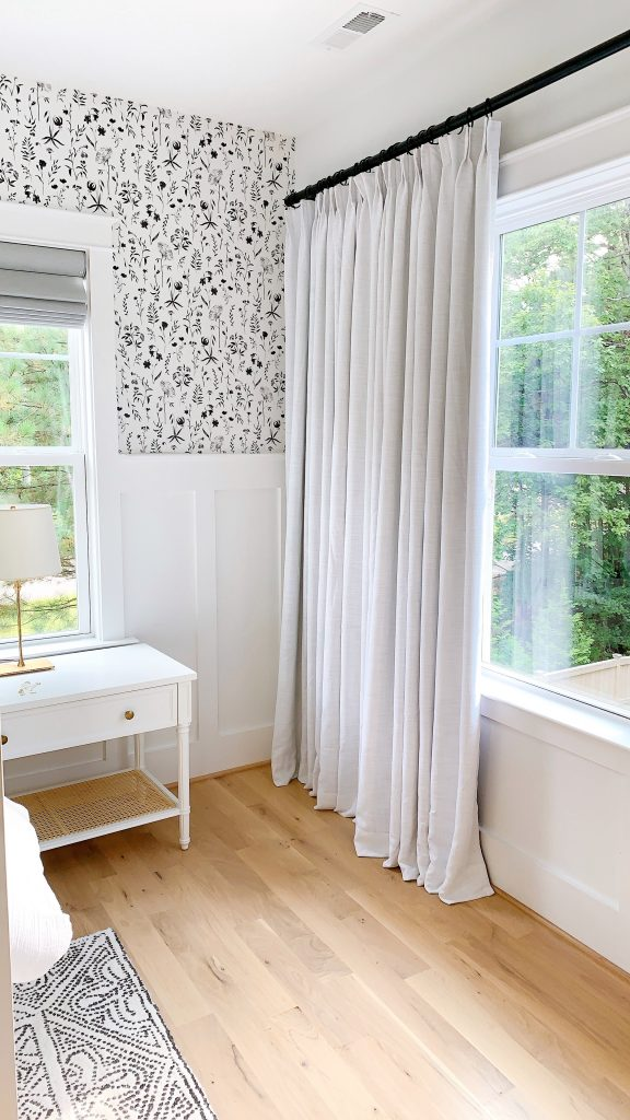 white drapes in a black and white bedroom