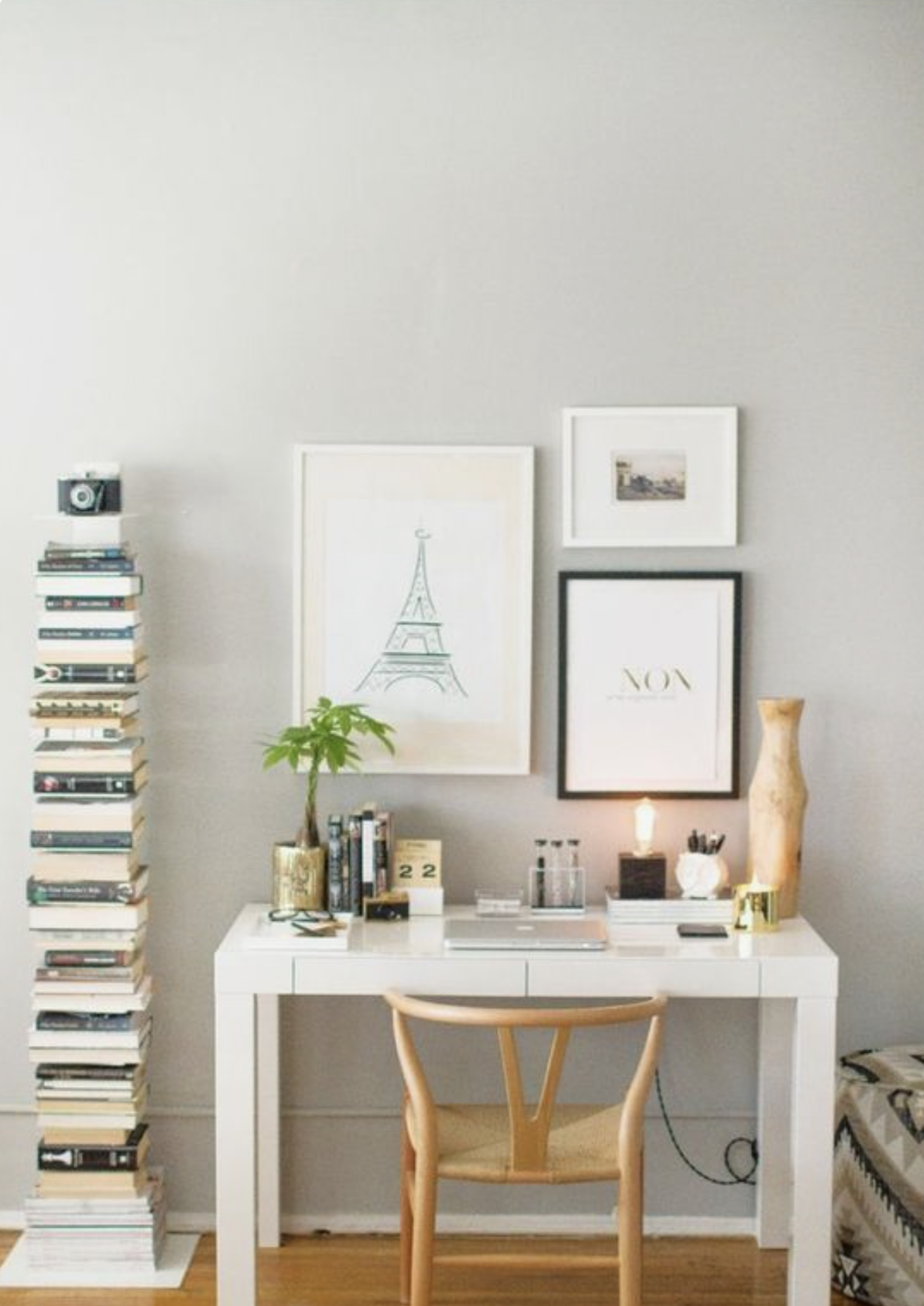 a parsons desk in every girl home office with a cute lamp and books