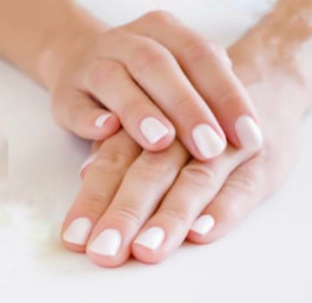 2 hands with gel manicures folded